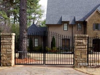12ft Wide Signature Grade Iron Driveway Gate with 6ft Arching to 7ft Profile - Mounted on Posts Behind Rock Columns (Style #1: Classic)