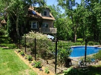 6ft Tall Traditional Grade Iron Fence Used as a Backyard Pool Enclosure (Style #1: Classic)