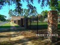 6 foot tall iron fence with custom triad finials and mounted between brick columns (Based on Style #1 - Classic)