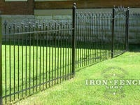 Custom 4ft Tall Iron Fence Panel and Arched Gate (Style #3 Staggered Finials) with Texas Star Finials and Stair Stepped for Grade