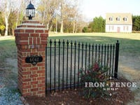 Custom Arched Entryway Iron Fence Panel on Brick Pillar
