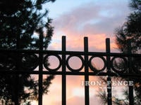 Custom Style Iron Driveway Gate with Rings and Plugged Pickets
