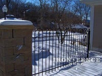 4 foot iron hoop and picket fence with stone pillar and light in winter (Victorian Hoop)