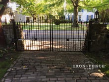 Our Classic Iron Driveway Gate Installed Behind Stone Columns