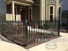 3ft Tall Wrought Iron Fence in Classic Style and Signature Grade in Front of a HIstoric Restored Home