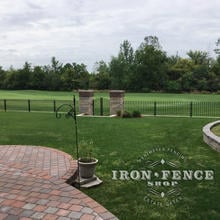 3ft Tall Signature Iron Fence Panels with Custom Gate Installed on a Brick and Stone Wall Top