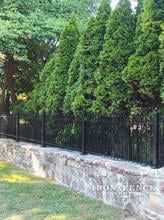 3ft Tall Iron Fence Installed on a Stone Wall with Flange Posts