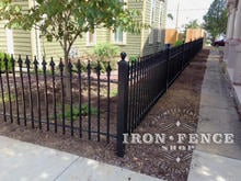 3ft Tall Wrought Iron Fence in Classic Style and Signature Grade used Along a Corner Sidewalk