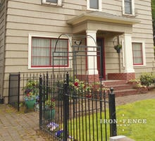 Traditional Grade Iron Fence in a 3ft Height and Classic Style Used to Complement an Arbor