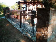 4 foot tall hoop and picket style iron fence with stone column