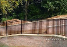 Our 54in Tall Infinity Aluminum Pool Style Fence Mounted on a Wall Top