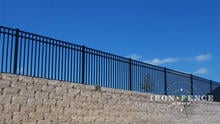 Our 54in Tall Infinity Aluminum Fence Panel in Traditional Grade on Top of a Wall