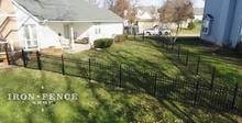 4ft Infinity Aluminum Fence Racked to Follow Grade in a Corner of a Yard Enclosure