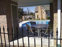 Our Classic Style Iron Fence with Finial Tips Around a Serene Pool Setting