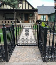 A Recessed Entryway Using Our Classic Iron Fence and Gate with Add-on Decorations
