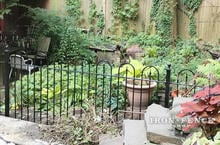 Our 4ft Tall Iron Fence in Hoop and Picket Style in a Garden Setting