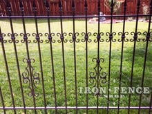 Guardian and Butterfly Add-on Decorations Added to a Traditional Grade Iron Fence Panel