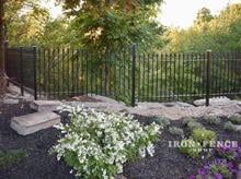 4ft Tall Signature Grade Classic Iron Fence Installed Along a Drop-off Garden