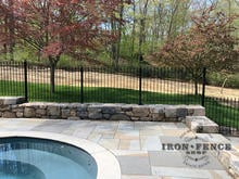 4ft Tall Classic Iron Fence Installed on a Wall Top Surrounding a Pool