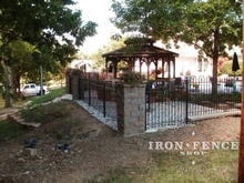 4ft tall iron hoop and picket fence panel with stone columns