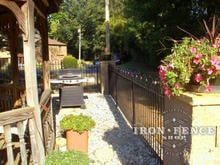 Side view of 4ft tall iron hoop and picket wrought fence