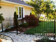 4ft tall wrought iron hoop and picket style fence with landscaping gravel underneath