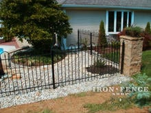 4ft tall wrought iron hoop and picket fence with stone corner column