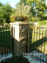4ft tall iron hoop and picket style fence with corner stone pillar
