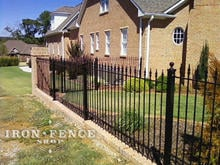 Our 4ft Tall Stronghold Iron Fence in Classic Style and Traditional Grade Stepped down a Brick Knee Wall with Flange Posts