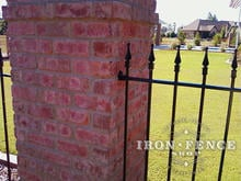 Our 4ft Tall Wrought Iron Fence Mounted to a Brick Column
