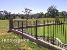 Our Classic Style Iron Fence Mounted on a Brick Wall with Columns Using Flange Posts