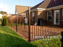 4ft (50in) Tall Wrought Iron Fence in Pool Style with Add-On Decorations Used Around a Patio