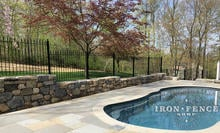 4ft Tall Wrought Iron Fence in Classic Style Stepped Down a Stone Wall