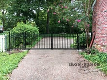Our 4x12 Infinity Aluminum Gate and Fence Closing off a Driveway