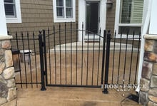 4x4 Wrought Iron Arched Gate in Entryway with Matching Iron Fence Panels and Flange Posts