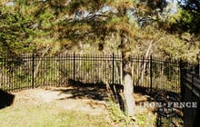 5ft Tall Aluminum Fence in Classic Style and Traditional Grade Curved Around a Backyard