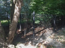Our 5ft Tall Classic Iron Fence Installed on a Wooded Lot