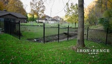 Wrought Iron Fence Stepped to Accommodate A Sloped Hill in the Yard