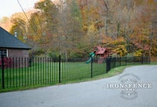 5ft Tall Wrought Iron Fence in Classic Style and Signature Grade Angled Around the Road