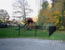 5ft Tall Wrought Iron Fence in Classic Style Surrounding a Play Area
