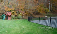 5ft Wrought Iron Fence Curved Around a Rounded Area with Straight Panels and Angle Brackets