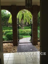6 Foot Tall Wrought Iron Arched Gate and Fence Installed in a Brick Archway (Signature Grade)