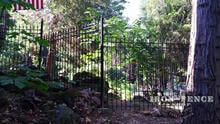 6ft Iron Fence Installed on an Incline with Angle Brackets and Stair-Stepping to Follow the Grade