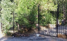 6ft Tall Wrought Iron Fence with 6x4 Iron Gate Installed Stair-Step Style to Follow Yard Grade