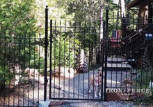 6ft Tall Wrought Iron Fence and Gate Stair Stepped to Follow Downhill Grade