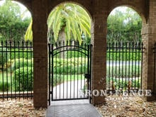 6ft Tall Wrought Iron Arched Gate and Fence Installed in a Brick Archway (Signature Grade)