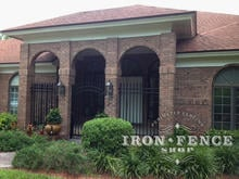 6ft Tall Wrought Iron Fence and Arched Gate Installed in a Brick Archway (Signature Grade)