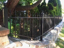 3ft Iron Fence Panel Installed on a Stone Wall Top with Flange Posts