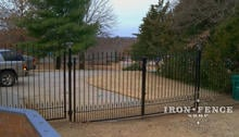 5ft tall wrought iron gate with double arch and puppy pickets