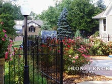 Iron hoop and picket style fence in a 4ft height and Traditional grade